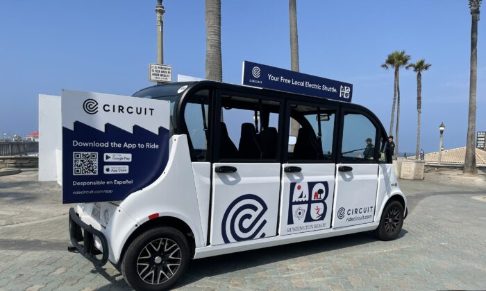 Huntington Beach's five-month Circuit car program, which will run through December, features five low-speed electric shuttles designed by Circuit.  (Drew Van Voorhis/The Epoch Times)