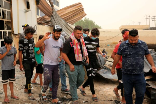 Rescuers and civilians look for bodies