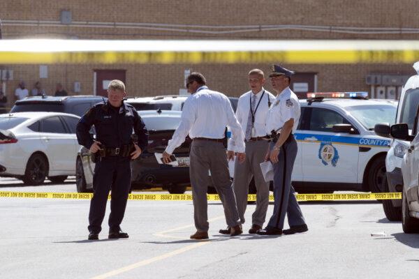 Law enforcement officials confer