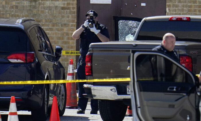 Shattered glass is seen on a pickup's driver side door as investigators document the scene in a mall parking area in Baltimore, Md., on July 13, 2021. (Julio Cortez/AP Photo)