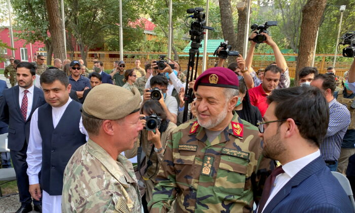 U.S. General Austin Miller (L) shakes hand with Afghan Defense Minister Bismillah Khan Mohammadi, at a ceremony in Kabul, as Miller relinquishes command during the final phase of America's withdrawal from the war in Afghanistan, on July 12, 2021. (Phil Stewart/Reuters)