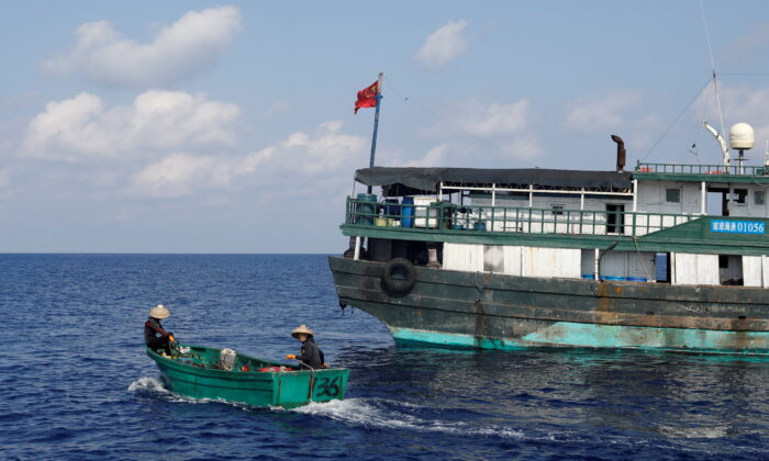 Chinese fishermen head to the shoal to fish at the disputed Scarborough Shoal, on April 6, 2017. (Erik De Castro/File Photo/Reuters)
