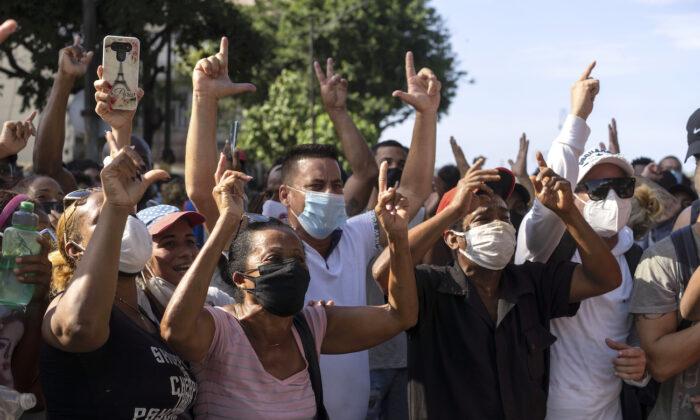 Cuban protesters march in Havana, Cuba, on July 11, 2021. (Eliana Aponte/The Associated Press)