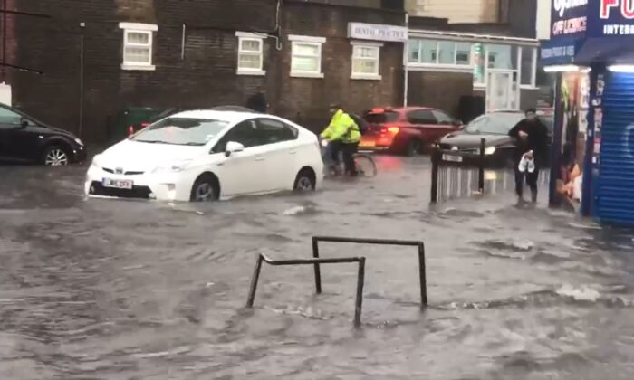 A flooded road in Turnpike Lane, north London, after heavy rainfall, on July 12, 2021. (@braggendasz/PA Media)