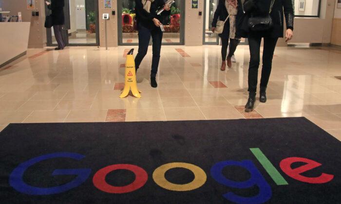 Google employees walk out of Google France building in Paris on Nov. 18, 2019. (Michel Euler/File/AP Photo)