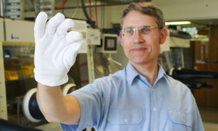 Paul Dastoor, Physicist and Research Leader at the University of Newcastle, holds a non-invasive, printable saliva test strip for diabetics, at the University of Newcastle in Newcastle, New South Wales, Australia, in this undated recent picture obtained by Reuters on July 12, 2021. (Courtesy of University of Newcastle/Handout via Reuters)