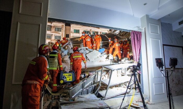 Rescue workers work at the site where a hotel building collapsed in Suzhou, Jiangsu province, China, on July 12, 2021. (China Daily via Reuters)