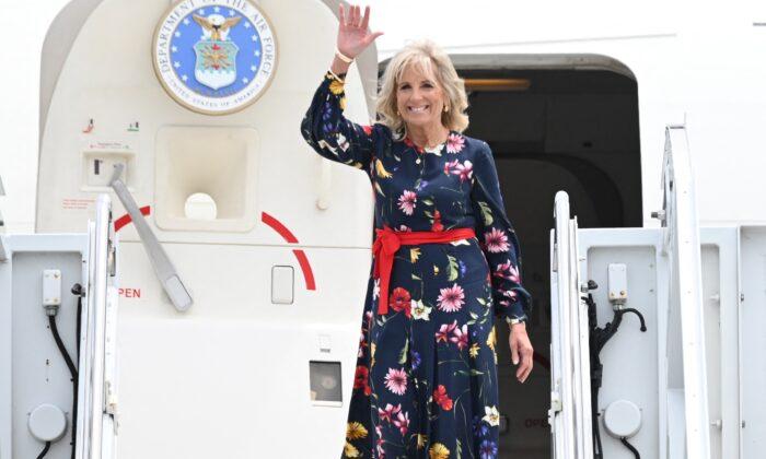 First Lady Jill Biden waves as she walks off the plane as she arrives in Savannah, Ga., on July 8, 2021. (Jim Watson/Pool/AFP via Getty Images)