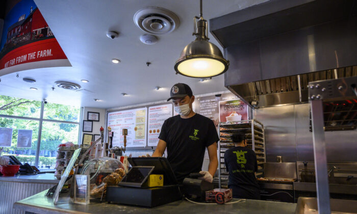 A teenager at work in a fast food restaurant in Arlington, Va., on June 6, 2021.  (ERIC BARADAT/AFP via Getty Images)