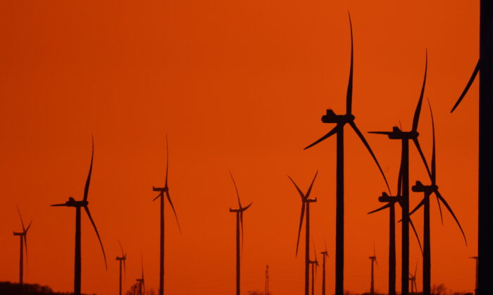 Power-generating windmill turbines are pictured during sunset at a wind park in Havrincourt, France, on April 14, 2021. (Pascal Rossignol/Reuters)