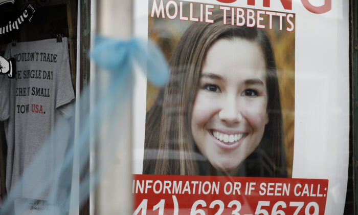 A poster for missing University of Iowa student Mollie Tibbetts hangs in the window of a local business in Brooklyn, Iowa on Aug. 21, 2018. (Charlie Neibergall/AP Photo, File)