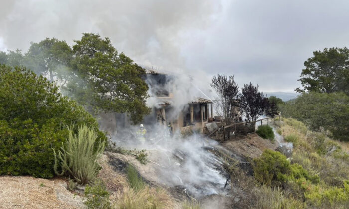 The scene where a plane crashed into a home near Highway 68 in Monterey County, Calif., on July 13, 2021. (Monterey County Regional Fire District via AP)
