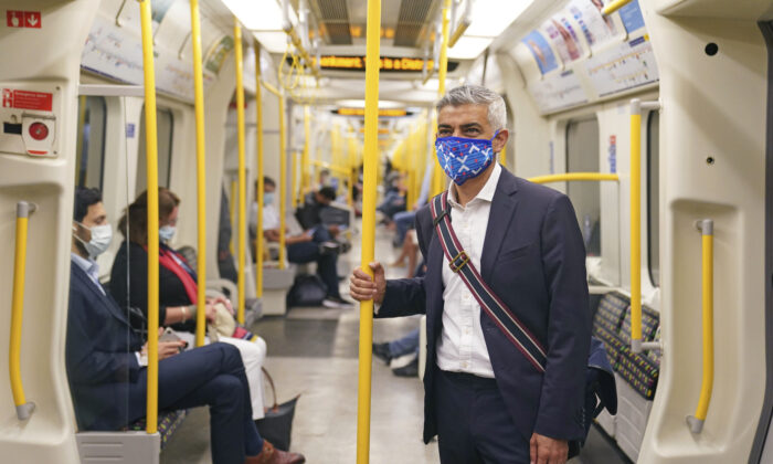 Mayor of London Sadiq Khan wears a mask as he rides on a Circle Line tube train to visit the London Transport Museum, in London, on July 14, 2021. (Kirsty O'Connor/PA via AP)
