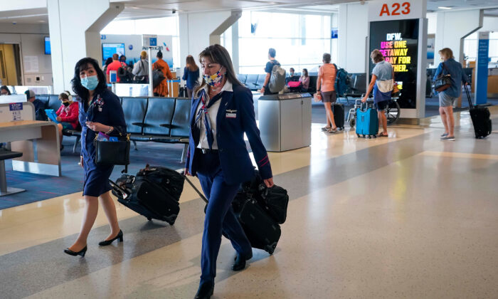 American Airlines flight attendants walk along the concourse at DFW International Airport in Dallas, Texas, in a file photo. (Smiley N. Pool/Dallas Morning News/TNS)