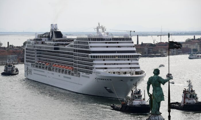 A MSC Magnifica cruise ship, seen from San Maggiore's bell tower, carried by three tugboats arriving in the Venice Lagoon on June 9, 2019. (Miguel Medina/AFP via Getty Images)