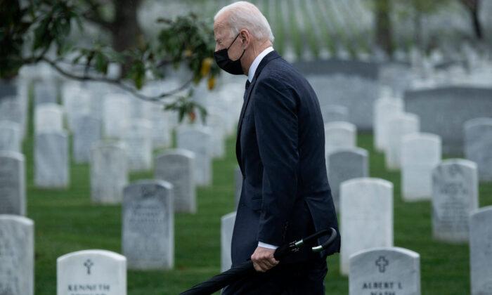 President Joe Biden walks through Arlington National Cemetery to honor fallen veterans of the Afghan conflict in Arlington, Va., on April 14, 2021. (Brendan Smialowski/AFP via Getty Images)