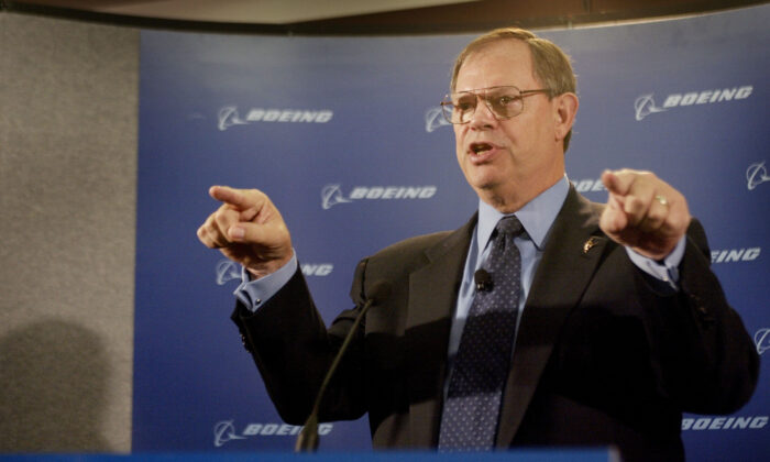 Boeing Chairman and CEO Phil Condit addresses the media following the company's annual shareholders meeting in Chicago on April 28, 2003. (Scott Olson/Getty Images)