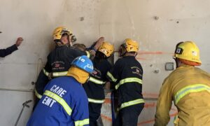 Firefighters Rescue Woman Wedged Between Two Concrete Walls