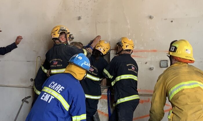 Firefighters rescued a woman trapped between two concrete walls in Santa Ana, Calif., July 13, 2021. (Courtesy of the Orange County Fire Authority)