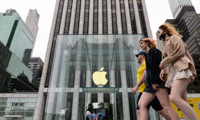 People walk past an Apple retail store in New York on July 13, 2021. (Angela Weiss/AFP via Getty Images)