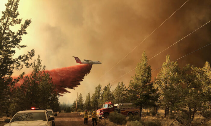 A firefighting tanker makes a retardant drop over the Grandview Fire near Sisters, Ore., on July 11, 2021. (Oregon Department of Forestry via AP)