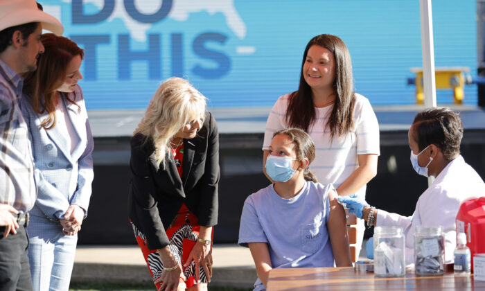 Singer & songwriter Brad Paisley, Kimberly Williams-Paisley, and First Lady Jill Biden tour a Pop-Up Vaccination site at Ole Smoky Distillery in Nashville, Tenn., on June 22, 2021. (Jason Kempin/Getty Images)