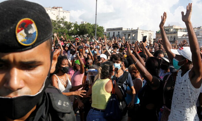 People react during protests amid in Havana, Cuba, on July 11, 2021. (Stringer/Reuters)