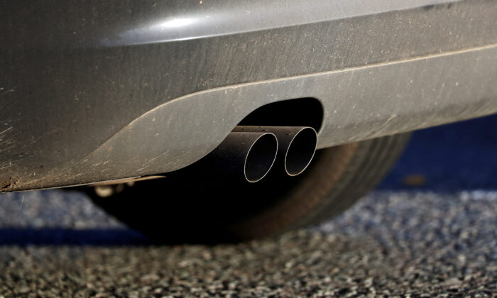 An exhaust pipe is seen as a vehicle sitting in traffic approaches the Blackwall Tunnel in London on Nov. 18, 2020. (Simon Dawson/Reuters)