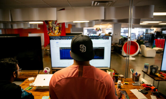 Software engineers Adrian Eufracio, right, and Digant Jagtap work together at Zeeto, an internet marketing company, in San Diego, Calif., on May 28, 2019. (Sam Hodgson/The San Diego Union-Tribune/TNS)