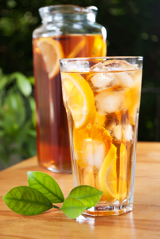 Glass,Of,Ice,Tea,With,Lemon,And,Pitcher,On,A