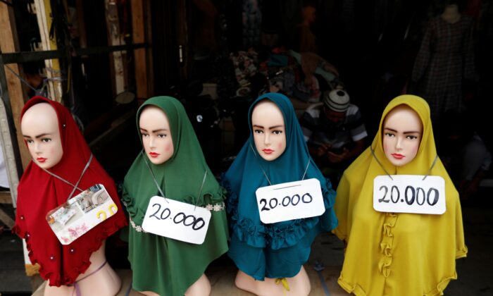 Hijabs for sale at Tanah Abang wholesale market for textile in Jakarta, Indonesia, on May 20, 2020. (Willy Kurniawan/Reuters)