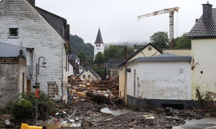 Collapsed buildings are seen on a flood-affected area following heavy rainfalls in Schuld, Germany, on July 15, 2021. (Wolfgang Rattay/Reuters)