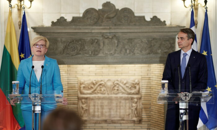 Greek Prime Minister Kyriakos Mitsotakis and his Lithuanian counterpart Ingrida Simonyte attend a news conference following their meeting at the Maximos Mansion in Athens, Greece, July 15, 2021. (Dimitris Papamitsos/Greek Prime Minister's Office/Handout via Reuters)