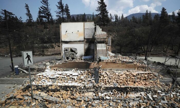 Damaged structures are seen in Lytton, B.C., on July 9, 2021, after a wildfire destroyed most of the village on June 30. (The Canadian Press/Darryl Dyck)