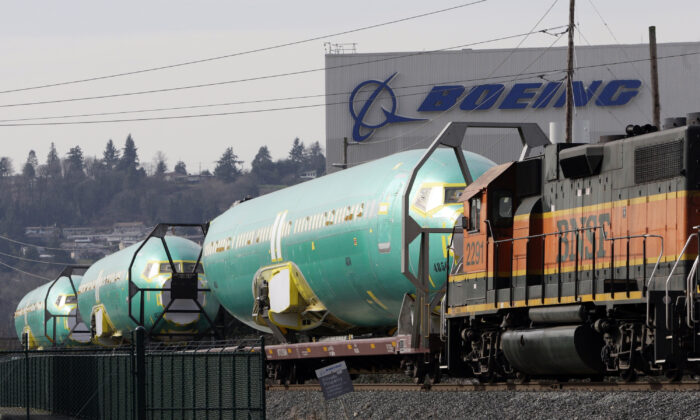 Boeing 737 fuselages are delivered by Burlington Northern Santa Fe (BNSF) train to a Boeing manufacturing site in Renton, Washington on Feb. 27, 2014. (Jason Redmond/Reuters)