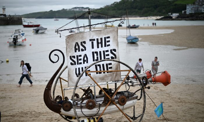 A boat sculpture is pictured during a climate change protest on the beach in St Ives, Cornwall, England, during the G7 summit on June 11, 2021.  (Daniel Leal-Olivas/AFP via Getty Images)