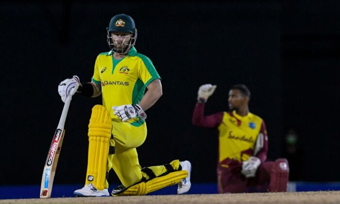 Matthew Wade (L) of Australia kneels for Black Lives Matter during the 4th T20I between Australia and West Indies at Darren Sammy Cricket Ground, Gros Islet, Saint Lucia, on July 14, 2021. (Randy Brooks/AFP via Getty Images)