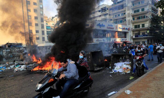 Saad Hariri's supporters block streets in Beirut, Lebanon, on Thursday, July 15, 2021. (Hussein Malla/AP Photo)