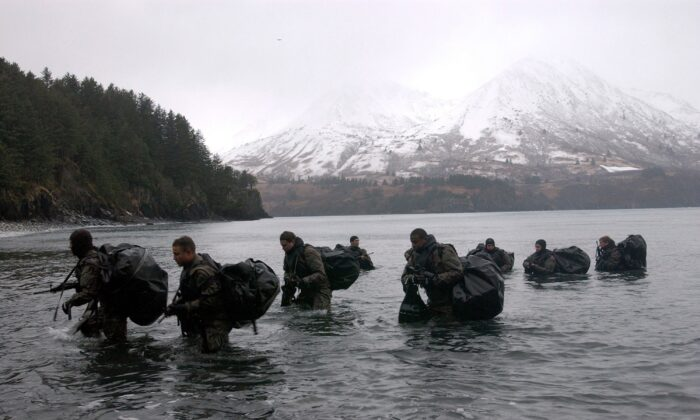 Navy SEALs perform Advanced Cold Weather training to experience the physical stress of the environment and how their equipment will operate, or even sound, in adverse conditions in Kodiak, Alaska on December 14, 2003. (Photo by Photographer's Mate 2nd Class Eric S. Logsdon/U.S. Navy via Getty Images)