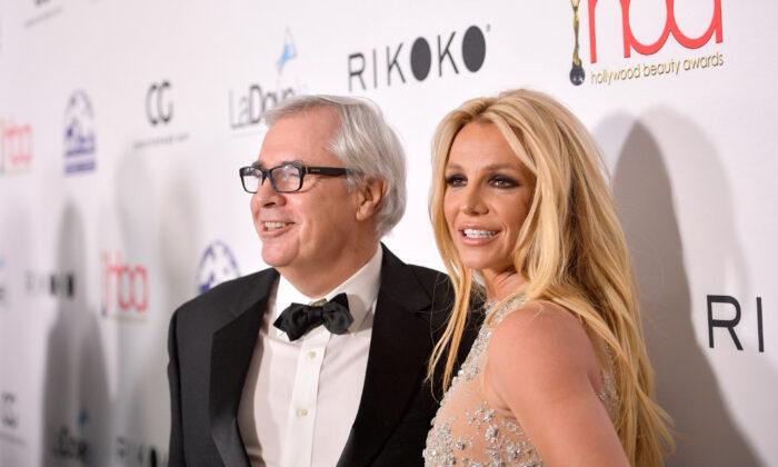 Elizabeth Arden EVP Global Fragrance Marketing Ron Rolleston (L) and singer Britney Spears attend an event at Avalon Hollywood in Los Angeles, Calif. on Feb. 25, 2018. (Matt Winkelmeyer/Getty Images)
