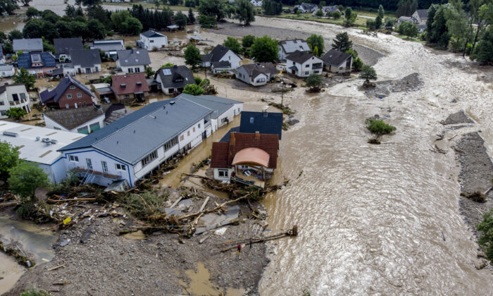 Damaged houses are seen at the Ahr river in Insul, western Germany, on July 15, 2021. (Michael Probst/AP Photo)