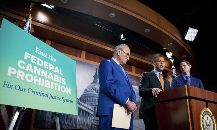(L-R) Senate Majority Leader Chuck Schumer (D-N.Y.), Sen. Cory Booker (D-N.J.), and Sen. Ron Wyden (D-Ore.) announce a draft bill that would decriminalize marijuana on a federal level, in Capitol Hill in Washington on July 14, 2021. (Amanda Andrade-Rhoades/AP Photo)