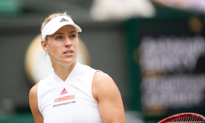 Angelique Kerber (GER) seen on court playing Ashleigh Barty (AUS) in the women's singles quarter final match at All England Lawn Tennis and Croquet Club on Jul 8, 2021. (Peter van den Berg-USA TODAY Sports/File Photo)