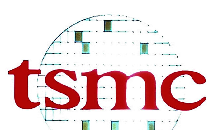 The logo of Taiwan Semiconductor Manufacturing Co. (TSMC) is displayed during a third quarter press conference in Taipei, Taiwan, on Oct. 27, 2005. (Chiang Ying-ying/File/AP Photo)