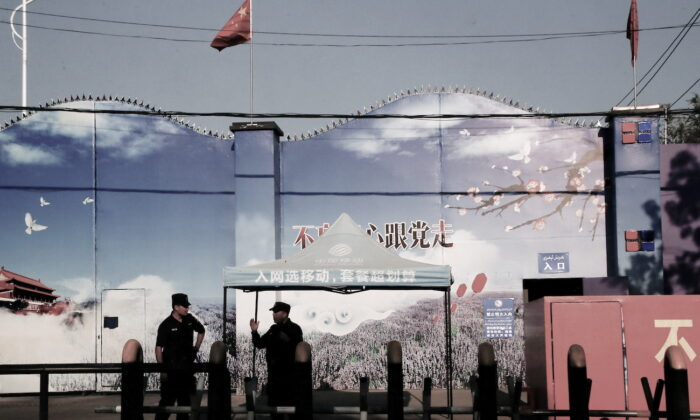 Security guards stand at the gates of what is officially known as a vocational skills education center in Huocheng County in Xinjiang Uyghur Autonomous Region, China, on Sept. 3, 2018. (Thomas Peter/Reuters)