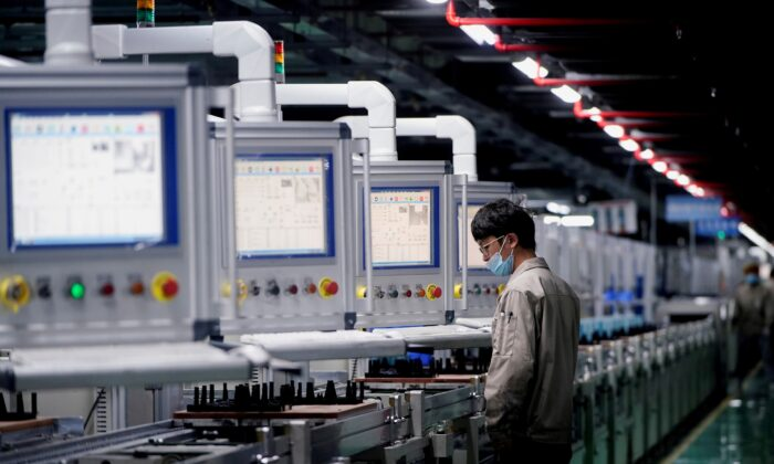 An employee works on the production line of electric vehicle (EV) battery manufacturer Octillion in Hefei, Anhui province, China, on March 30, 2021. (Aly Song/Reuters)
