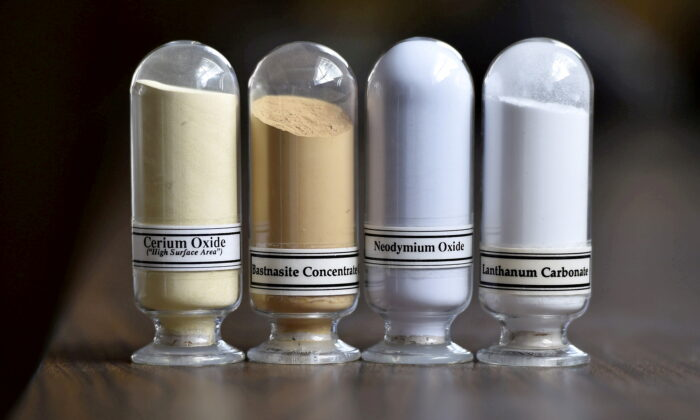 Samples of rare earth minerals from left: Cerium oxide, bastnaesite, neodymium oxide and lanthanum carbonate at Molycorp's Mountain Pass Rare Earth facility in Mountain Pass, Calif., on June 29, 2015. (David Becker/Reuters)