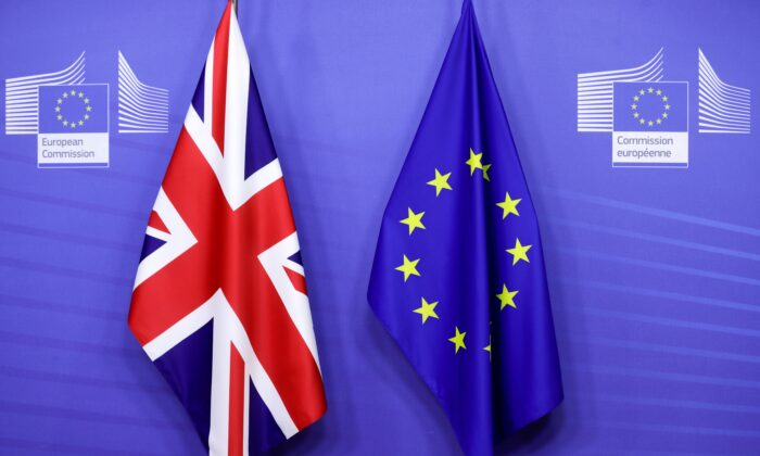 Flags of the Union Jack and European Union are seen ahead of the meeting of European Commission President Ursula von der Leyen and British Prime Minister Boris Johnson, in Brussels, Belgium, on Dec. 9, 2020. (Olivier Hoslet/Pool via Reuters)