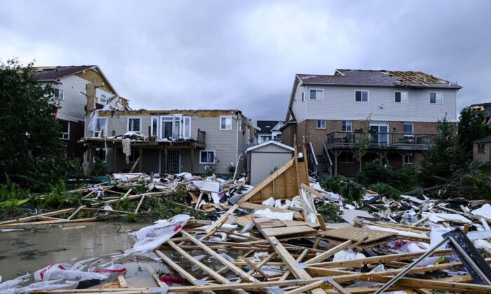 Damage left after a tornado touched down in a neighbourhood of Barrie, Ont., on July 15, 2021. (The Canadian Press/Christopher Katsarov)