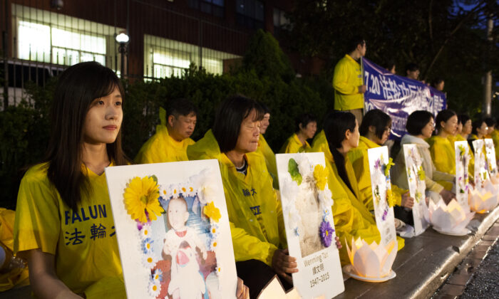 Falun Gong adherents attend a candlelight vigil in front of the Chinese Consulate in Toronto on July 15, 2021, marking 22 years of persecution by the Chinese communist retime and calling on the regime to end its persecution of their spiritual practice in China. (Evan Ning/The Epoch Times)